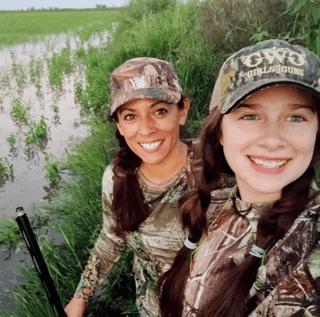 Huge-smiles-hunting-in-the-rice-fields-Lea-Leggitt-photo.png